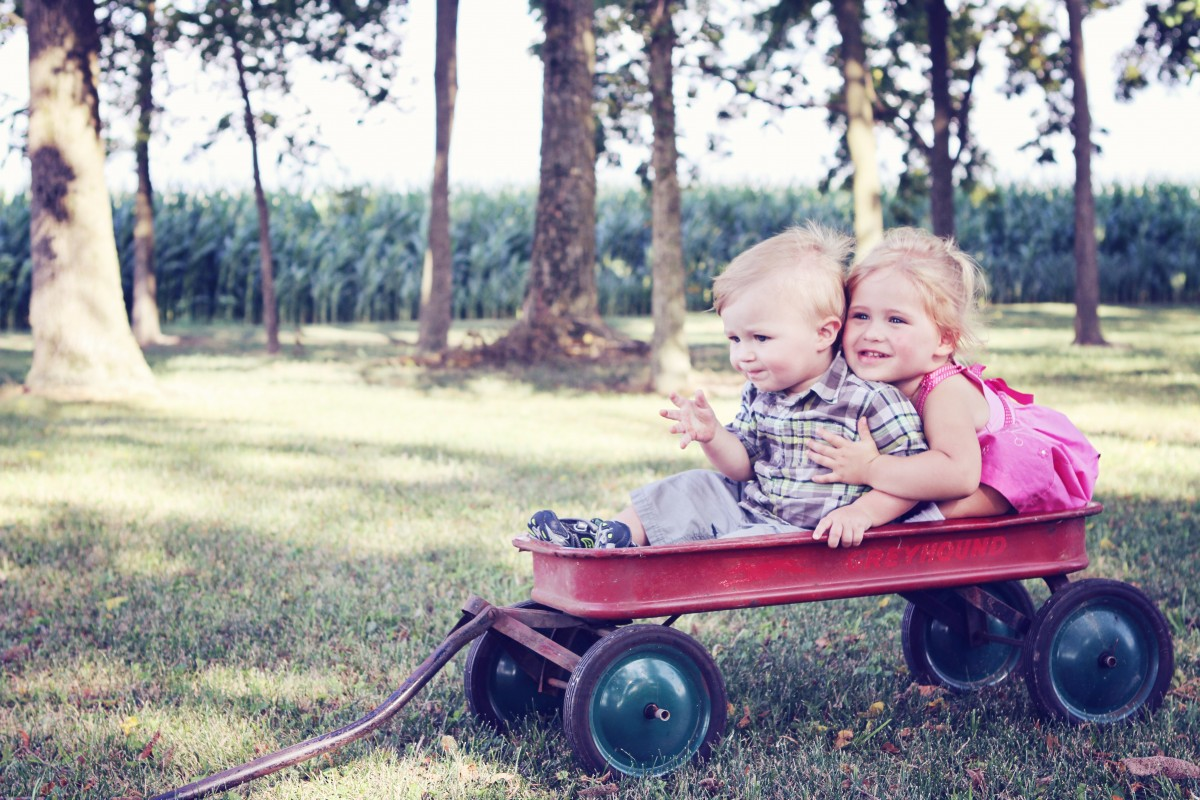 Healthy and happy children playing in wagon - Royston Health Trust